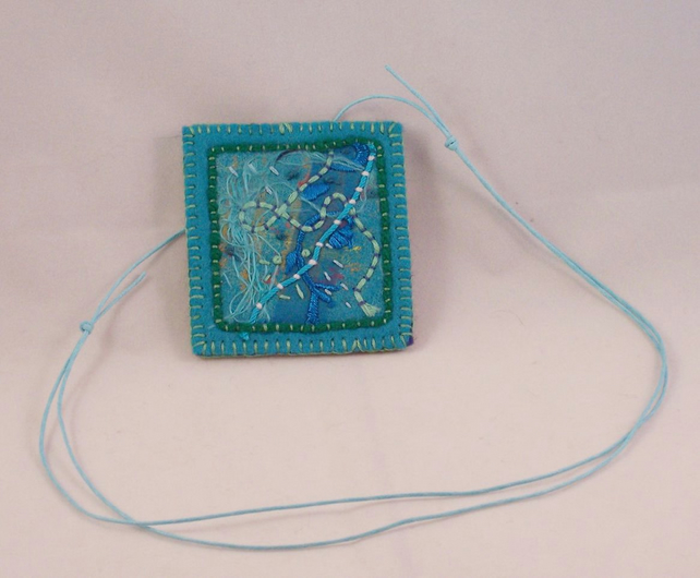Hand embroidered textile necklace - Atlantis