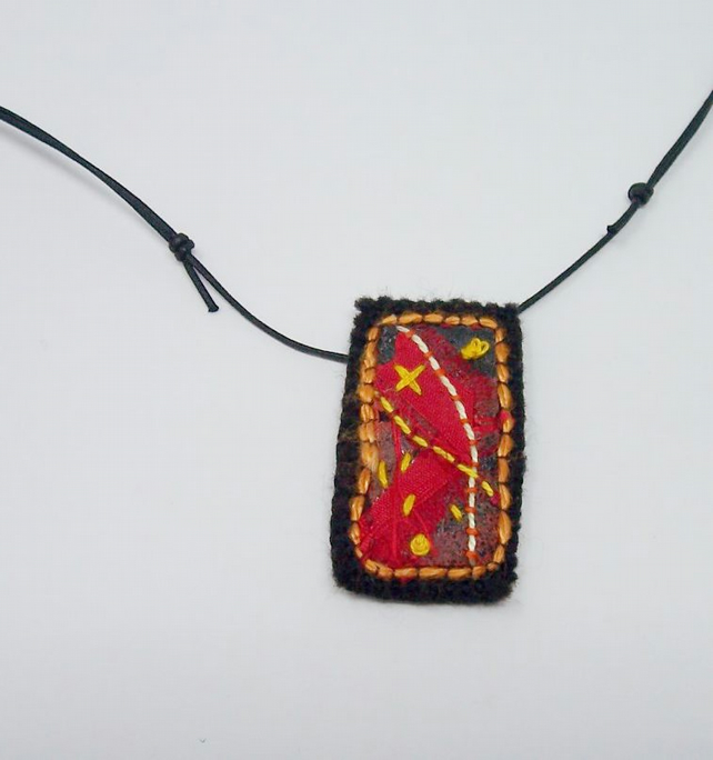 Hand embroidered textile necklace - Flame