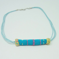 Embroidered fabric bead necklace with waxed cotton cord - Reef