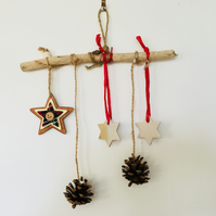 Ceramic driftwood christmas decoration, pine cones, pottery and driftwood