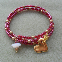 Rasberry and gold Memory Wire Bracelet