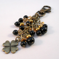 Four Leaf Clover Bag Charm In Black and Gold