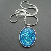 Blue Glitter Resin Pendant With Woven Silver Plated Chain