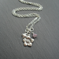 Silver plated necklace with heart and flower charms