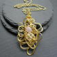 Wire Pendant With Gold Coloured Wire and Semi Precious Gemstones