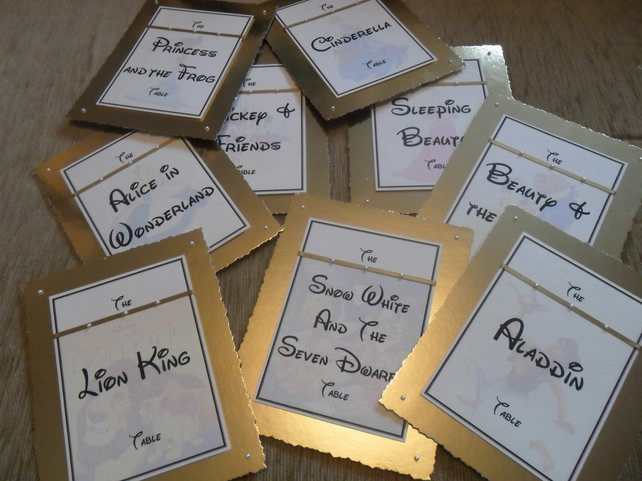 Disney themed wedding table names gold coloure folksy for Design table name cards