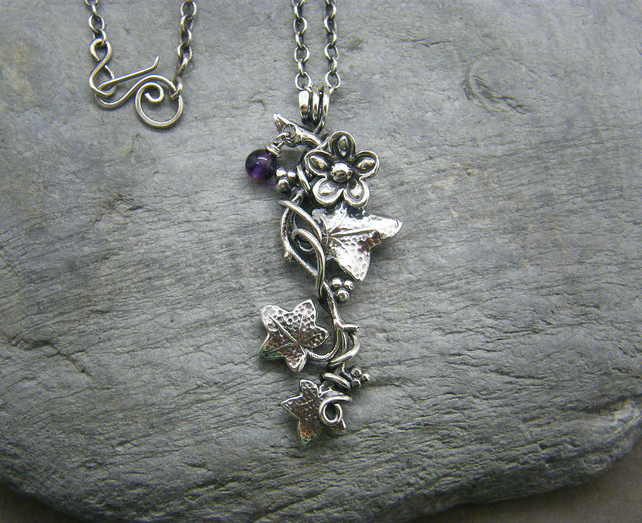 Sterling silver ivy leaf necklace with flower details and amethyst gemstone