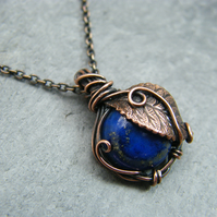 Antique copper lapis lazuli pendant necklace with leaf details
