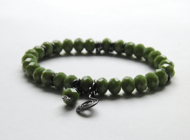 Green Bracelet with Oxidised Silver Swirl Charms