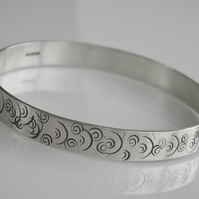 Sterling Silver Bangle with Spiral Design.