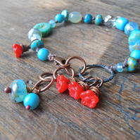 aqua and red knotted bracelet