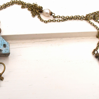 handmade ceramic cottage and keys long necklace in speckled robin's egg blue