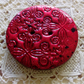 Metallic red polymer clay button