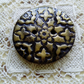 Gold patterned polymer clay button