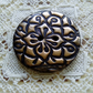 Bronze patterned polymer clay button