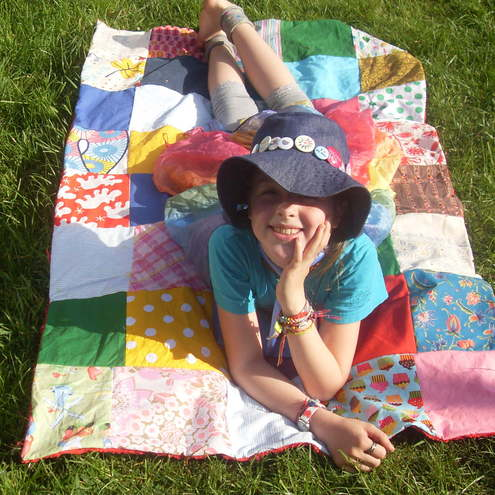 red small patchwork squares blanket or picnic rug