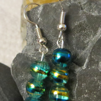 Blue and gold glass swirl beaded earrings