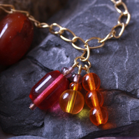 Multi-coloured gold plated charm necklace - pink, orange and yellow