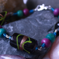 Purple glass and wooden beaded bracelet