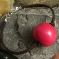 Pink wooden bead faux suede cord bracelet