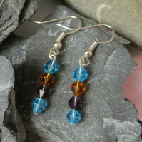 Southwestern USA inspired glass beaded earrings orange blue purple