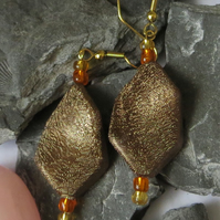 Twisted gold, orange and yellow beaded earrings