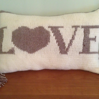 Hand knitted love cushion