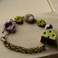 Ceramic Raku Green House Bead Bracelet with Purple and Green Czech Beads