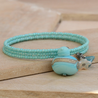 Turquoise Memory Wire Seed Bead Bracelet with Aqua Lampwork Glass Bird & Flowers