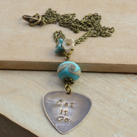Let It Go Hand Stamped Vintaj Pendant with Turquoise Lampwork Glass Bead