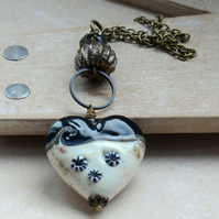 Lampwork Glass Cream and Blue Heart Necklace with Metal Urchin Bead
