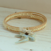 Gold and Cream Memory wire Bracelet with Blue Porcelain Bird