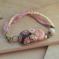 Pink and Cream Ceramic Life is a Song Bracelet with Sari Ribbon