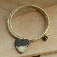 Memory Wire Wrap Cream Seed Bead Bracelet with Ceramic Black Cream Heart