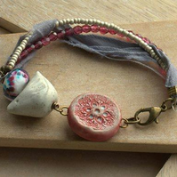 Bracelet with Ceramic Bird, Clay Connector, Ribbon, Lampwork and Czech Beads