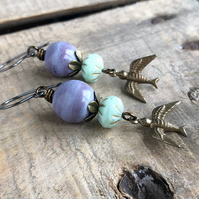 Whimsical Brass Flying Bird Earrings. Purple & Mint Green Earrings