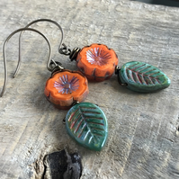 Rustic Green Czech Glass Leaf Earrings. Orange Flower Earrings. Nature Gift