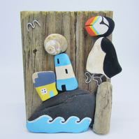 Pottery Puffin on Driftwood. Sea Pottery Beach Pebble Art Collage, Scotland.