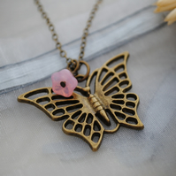 Butterfly & pink flower necklace