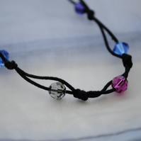 Swarovski crystal & black cord necklace, blue sapphire, purple, fuchsia