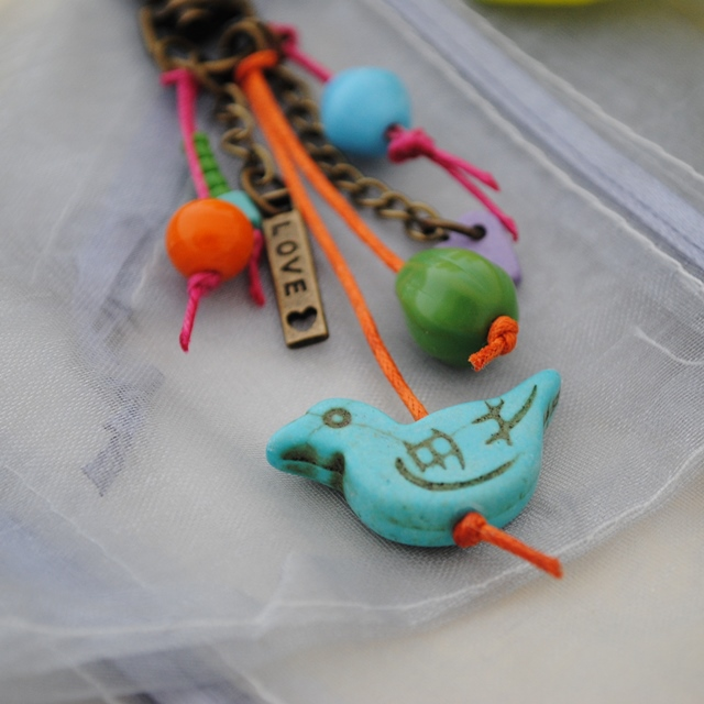 Turquoise bird colours bag charm