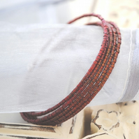 Red seed wrap (memory wire) Bracelet