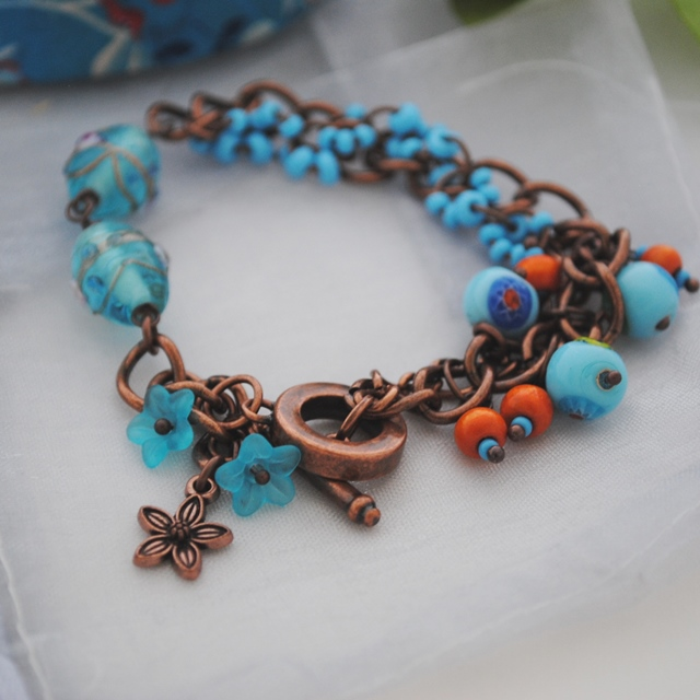 Turquoise & orange splash charm bracelet