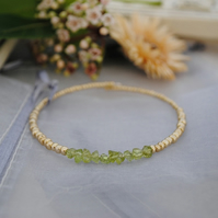 Peridot & gold bangle bracelet