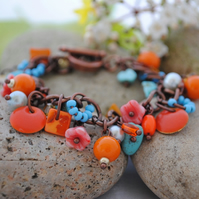 Turquoise and sunshine orange charm bracelet