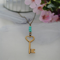 Brass key necklace with turquoise rondelles