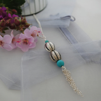 Silver bead long layering necklace with tassel and turquoise beads