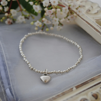 Silver heart and bead stretch bracelet