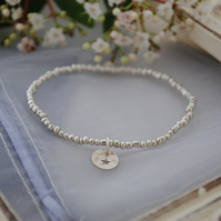 Silver charm and bead stretch bracelet