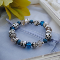 Silver and blue bead stretch bracelet
